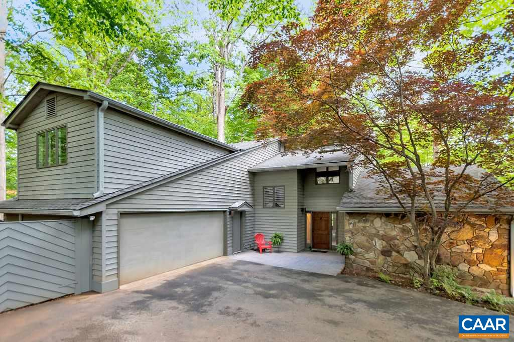 This contemporary home is a refreshing retreat set on a partially wooded (low maintenance) lot on a cul-de-sac in the convenient community of Woodbrook. Enjoy the spectacular LR w/ stone fireplace, vaulted custom ceiling & sunny windows. Eat in kitchen w/ in & under cabinet lighting has all the snazzy appliances & storage you'll ever need. Mudroom is outfitted with gorgeous cabinetry + in close proximity to the Speed Queen W&D. The Family Room is a private space w/ lots of windows, built-ins and gas stove  where you'll feel like you're in a tree house. Three outdoor porches, including a screened porch w/ gas stove, provide multiple spaces for family and friends. Two-zone HVAC. New gutters. An absolute gem of a home - so unique and spacious!