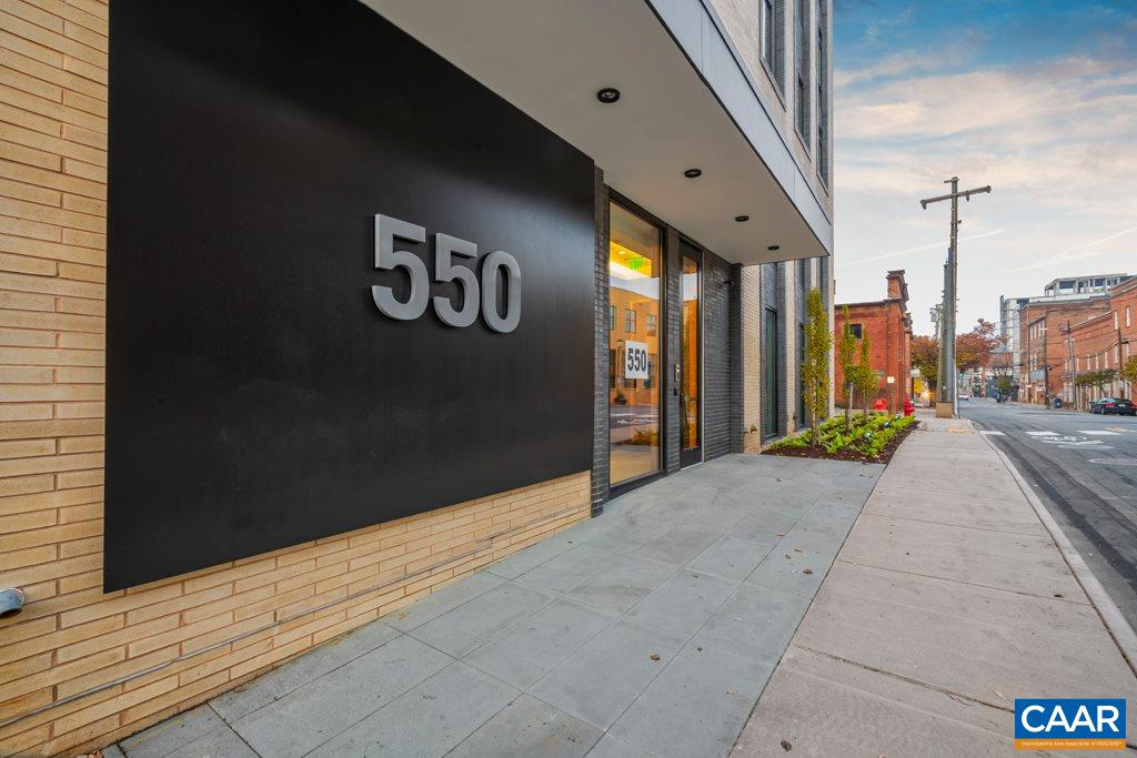 The 550 is an ultra-premium, boutique-scale condo building located 1 block off the Downtown Mall.  This dramatic, glass & brick structure designed by Formwork & constructed by Martin Horn was awarded the most influential residential construction project of 2018 by the Urban Land Institute. The building will be comprised of as few as 4 residential units or as many as 7. This 3rd floor finished unit enjoys a covered terrace (427 sf) plus a huge rooftop deck (1,750 sf!) with views of Charlottesville's vibrant downtown scene and mountains beyond. Large windows, an open floor plan, secure garage parking (2 spaces!) & storage unit.  This price is for a fully finished, full floor 4 bedroom, 3.5 bath unit with direct elevator access into the foyer.