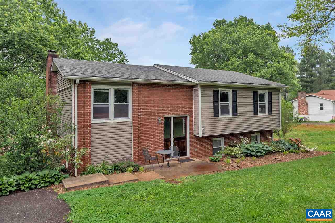 Under $275K in Crozet! This 3 bedroom, 3 bath home a short walk to Crozet Park (year-round pool, soccer field, playgrounds, lighted baseball diamonds, dog park!) has a renovated kitchen with granite counters, hardwood floors, three bedrooms and two full baths on the main level. Downstairs offers the rec room with brick, wood-burning fireplace, an office/bedrooms, another full bathroom, utilities, and loads of storage. And outside - large yards, front and back - mature trees, full grass, and a fenced back yard. So much to enjoy here, including a short walk or bike ride to the Crozet Trails and Downtown Crozet.