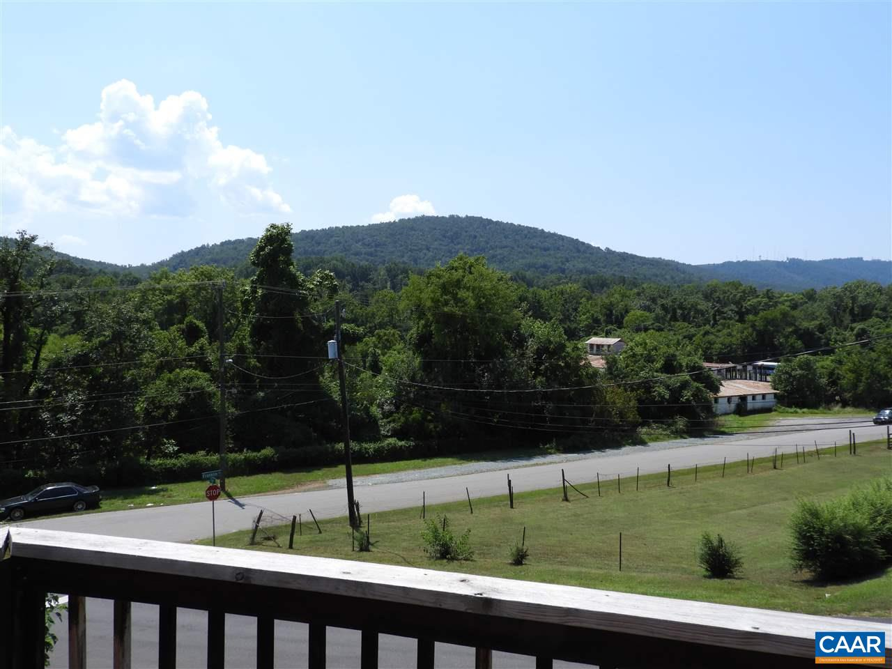 Wonderful Belmont opportunity with gorgeous mountain views. This home has lots of space, wood floors and two  decks to enjoy the view.  The large detach shed makes a great workshop with electric and rough in plumbing.  This location has easy access to all Charlottesville has to offer.  Interstate 64 is a few minutes away.