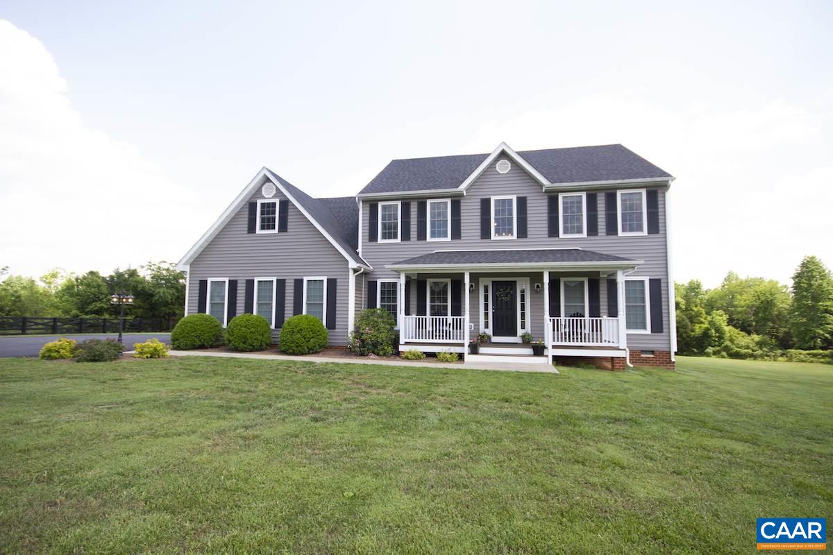 Custom built 5 year old home sits on five level sunny acres. Just a short drive from Charlottesville this beautiful colonial features: 2 story grand foyer, formal DR, large kitchen w/ painted cabinets, granite countertops, Bertazzoni dual fuel range, SS appliances, 9' ceilings main level, 1st floor master, living room w/ gas fireplace, 3 bedrooms upstairs, full bath w/ separate large vanities, family room, walk in attic w/ tons of storage, foam back siding to keep the electric bills low, energy efficient double hung windows, attached oversize 2 car garage.  Outside there is custom stone patio with built in walls for seating, fire pit, and wide paved driveway with basketball court.  This home is in great condition & ready its new owners.
