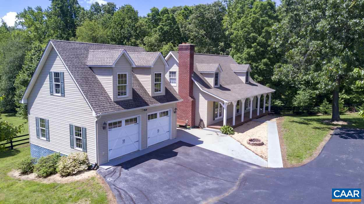 Located in Western Albemarle County & adjacent to King Family Vineyards, this property offers a picturesque setting with breathtaking views of the Blue Ridge Mountains. With three structures, situated on 6 acres, opportunities to enjoy peaceful vistas & the koi pond are numerous. The home contains 3 bedrooms, with a main-level master suite, living room with gas fireplace, eat-in kitchen with granite counters, gas cooktop, sunroom and a large rear deck. The attached two-car garage with walk-up attic offers great potential for expansion. A climate-controlled 30x30 workshop is located beside the main house. The detached cottage/guesthouse has one bedroom with a full kitchen and bath.