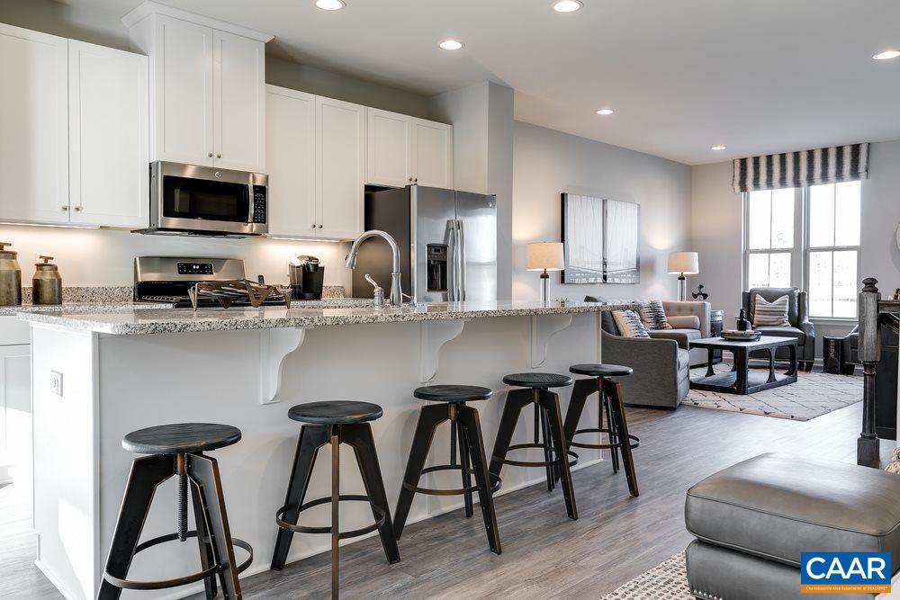 Garage townhomes JUST RELEASED FOR FALL MOVE-IN in at Riverwood, featuring Cville's lowest-priced new townhomes. The Strauss features a 1-car garage, open kitchen, expansive island, granite counters, maple cabinetry, stainless appliances, owner's suite with spa-like bath & walk-in closet, bedroom-level laundry, & a walkout basement with BEDROOM SUITE. Building your dream home has never been easier due to professionally designed options to choose from that have been preselected by an interior designer. Every new home is tested, inspected & HERS® scored by a 3rd party energy consultant & is inspected for quality by an independent 3rd party inspector. Purchase by 6/30/19 to receive $5,000 toward closing costs!*
