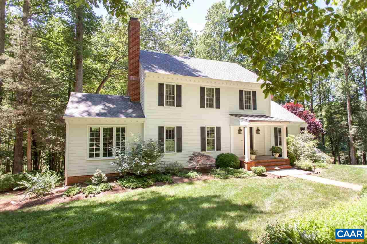 A magical setting that is close to all Charlottesville has to offer! Step inside to find a home full of beautiful details including HEART PINE FLOORS & BUILT-IN SHELVING. Main level includes cozy living room w/ FIREPLACE, bright airy SUNROOM w/ views of the pond, & family room w/ fireplace. Dining room extends to deck providing beautiful WATER VIEWS & space for relaxing or entertaining. Kitchen features COMMERCIAL-GRADE VIKING APPLIANCES, Virginia kyanite countertops, & plenty of storage. 2nd level features FINISHED ATTIC, 2 bedrooms, & master suite w/ WALK-IN CLOSET & FIREPLACE. Walk-out basement includes finished & unfinished storage space, lower level family room, full bath, & garage access. Close to Rt. 250 & a short drive to UVA.
