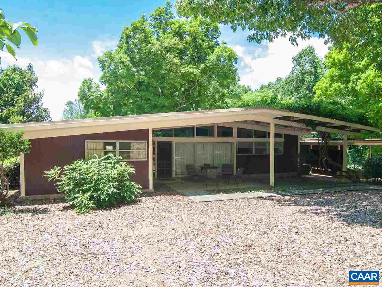 OPEN HOUSE - Aug. 11, 1-3. Mid Century Contemporary located in Ivy, less than 10 minutes from town & in  the desirable Meriwether Lewis/Western school district. Consisting of 2 parcels of  3.8 total acres, with the home on a parklike 2.21 acre setting which backs up to 1.8 acres of mostly open pasture land that is nearly fully fenced. There is a 2 stall horse barn with tack room, storage & workshop area. Electricity & water available. Uniquely charming home with a taste of the 50's, has a large soapstone patio for relaxation & conversation , 2 car carport & separate workshop. Inside featuring a great room with lovely views of the rear pastoral setting, built-in bookshelves, vaulted ceilings, & the charm of three interior stone walls.