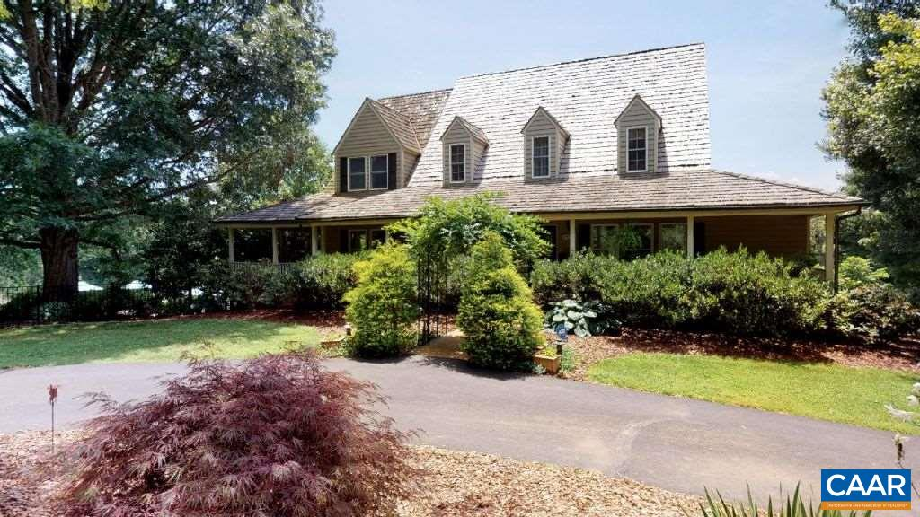 Unparalleled setting on 16.4 acres minutes to all K-12, private schools and Crozet. 4 Bed. 3.5 bath. Cedar/Brick. Remodel 2001. Custom Kitchen w/gas grill. Double ovens. New roof. Copper gutters. 3-Season room has access to kitchen and Wraparound porch with built-out hot tub and BBQ areas with steps down to pool, deck and H/C shower-change area. Landscape lights. Whole house air and water purification systems. Outage generator. Barn. Private pond w/Citation fish and dock. Coveted Division Right