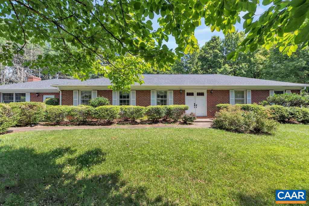 OPEN HOUSE, Sunday, July 14, 1-3PM. A Greenwood community gem perched perfectly atop a 2.5 acre private knoll with mature trees, a small meandering stream and an open sunny garden area. A solid built brick ranch home with all the updates to systems - all new SS kitchen appliances, new roof, gutters and 200AMP electrical panel. Newer Trane HVAC system and water heater. Neutralizer installed on the well. The spacious kitchen & family room w/ wood burning, brick surround fireplace is open to the large living room & dining room. Additional rec room with wood stove off of the kitchen/mud room. Covered back patio overlooks the yard. Pollak Vineyard less than .5 mile down the street. One owner owned home in the Western Albemarle school district!