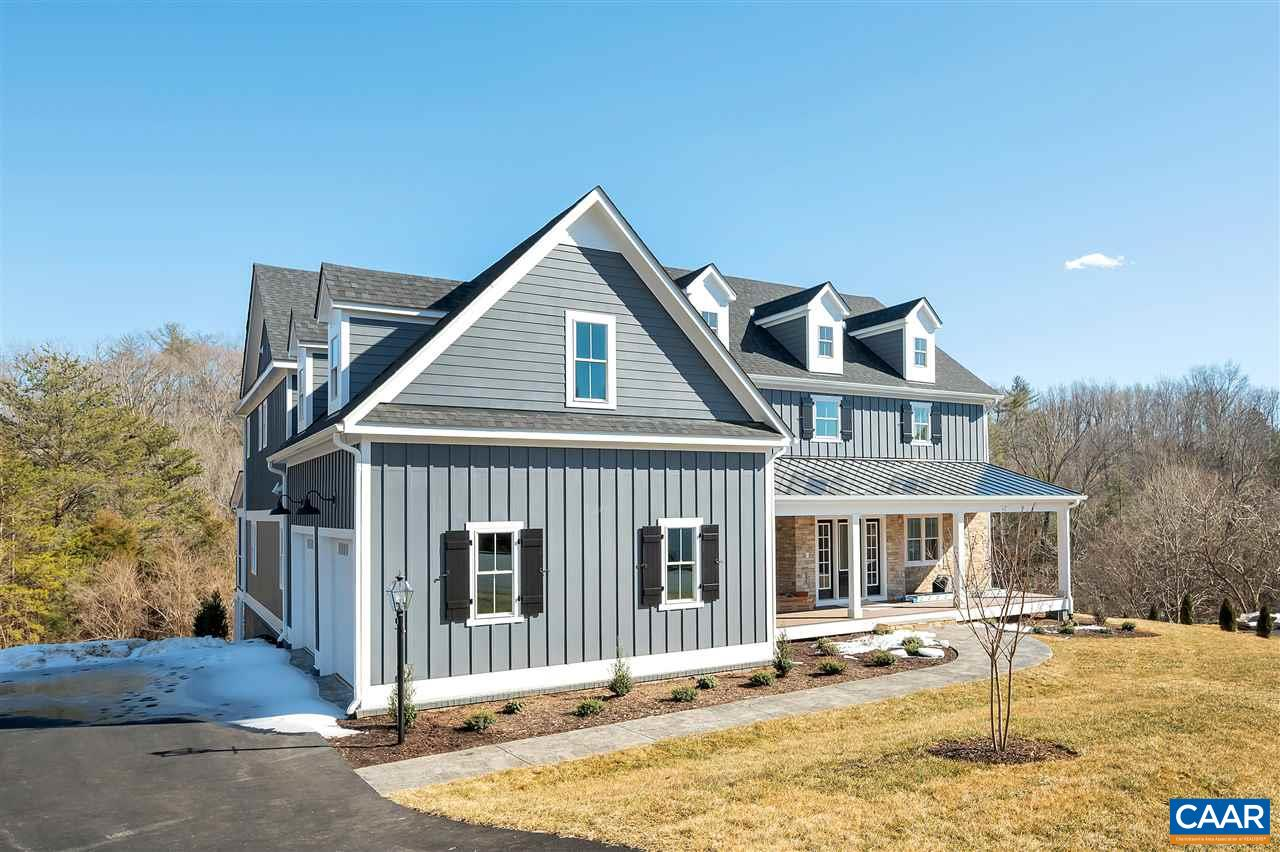 Another new offering in Foxchase Landing! New construction in Crozet, with *preserved trees* surrounding the neighborhood! 15 min to C'ville, 4 min to Western Albemarle schools, 2 min to Harris Teeter, and 7 min to one of Crozet's 3 coffee shops! This new custom home on a cul-de-sac offers large 1st floor master suite, 2nd bedroom and full bath on main level, wide open kitchen w/ breakfast area that opens to family room, hardwood floors throughout main level, large deck off the kitchen. Upstairs offers two bedrooms each with their own full bath attached, and an open loft. Full walkout basement! Southern Classic is a custom home builder dedicated to ensuring a home that fits you. 2x6 Construction & Superior Wall foundation.