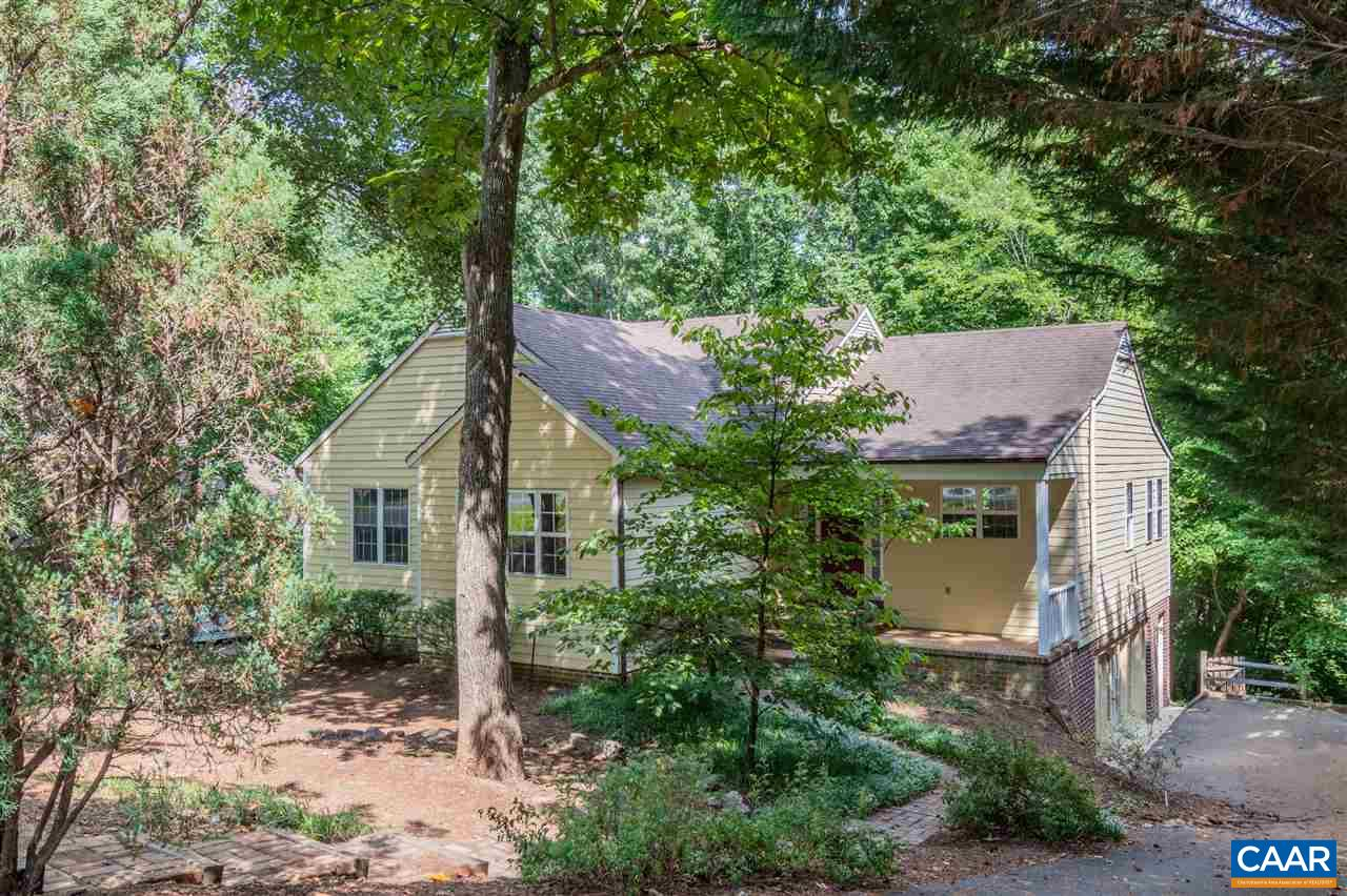Sought after Mill Creek cottage privately situated with 3+BRs, 3 full BAs plus finished walk-out terrace level. Minutes to Fifth Street Station and I64 and easy commute to UVA Grounds, Downtown Cville. One-level living, open floor plan, hardwood floors, vaulted ceilings, and built-in bookcases. LR w/ gas fireplace w/ access to rear deck overlooking private treed backyard. Dining area opens to large galley kitchen with newer appliances and handsome maple cabinets. Main level MBR w/ en suite bath, two other bedrooms that share hall bath. Terrace level includes playroom/game room/guest room, full bath, over-sized bonus room with partial kitchen and separate outside entrance. New HVAC 2018, added bonus room mini-split 2019, new stove 2020.