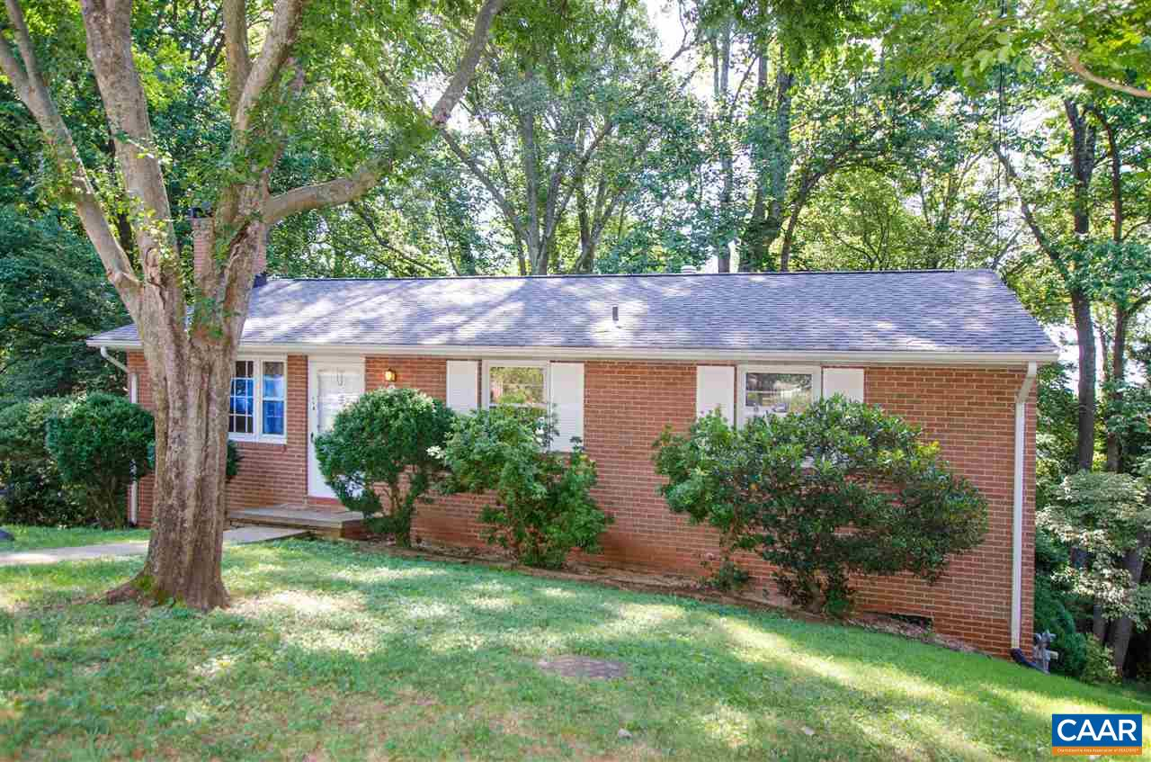 FRY'S SPRING BRICK gem with full WALKOUT BASEMENT on quiet CUL-DE-SAC. Great bones and opportunity to INVEST in this highly sought after community close to UVA, JPA, 5th Street Station, and all things C'ville! Gleaming HARDWOODS on main floor. EAT-IN KITCHEN opens to back DECK overlooking beautiful yard in a serene setting with mature trees and natural, huge stones. Wood-burning FIREPLACES in main level Living Room and large Basement Rec Room. Basement has NEW CARPET and also boasts drop ceiling, recessed lights, large window, and laundry. Corning System in basement includes walls, ceiling, lighting, adjustable venting for heat and AC, and fire alarm. Basement opens to lovely back yard with park grill and wooded view. Recent roof