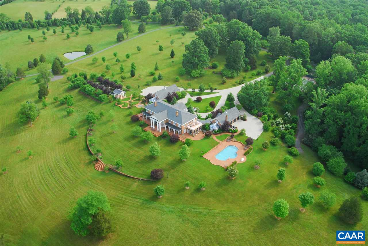 Luxurious 140-acre estate property located within minutes of the University of Virginia and 9 minutes to airport. Dramatic entry leads to 60 room brick manor home, Palladian in style, offering superior quality and details throughout. This magnificent estate property includes multiple residences, pool, formal gardens, brick walkways, pavilion, tennis court, barn and several ponds.