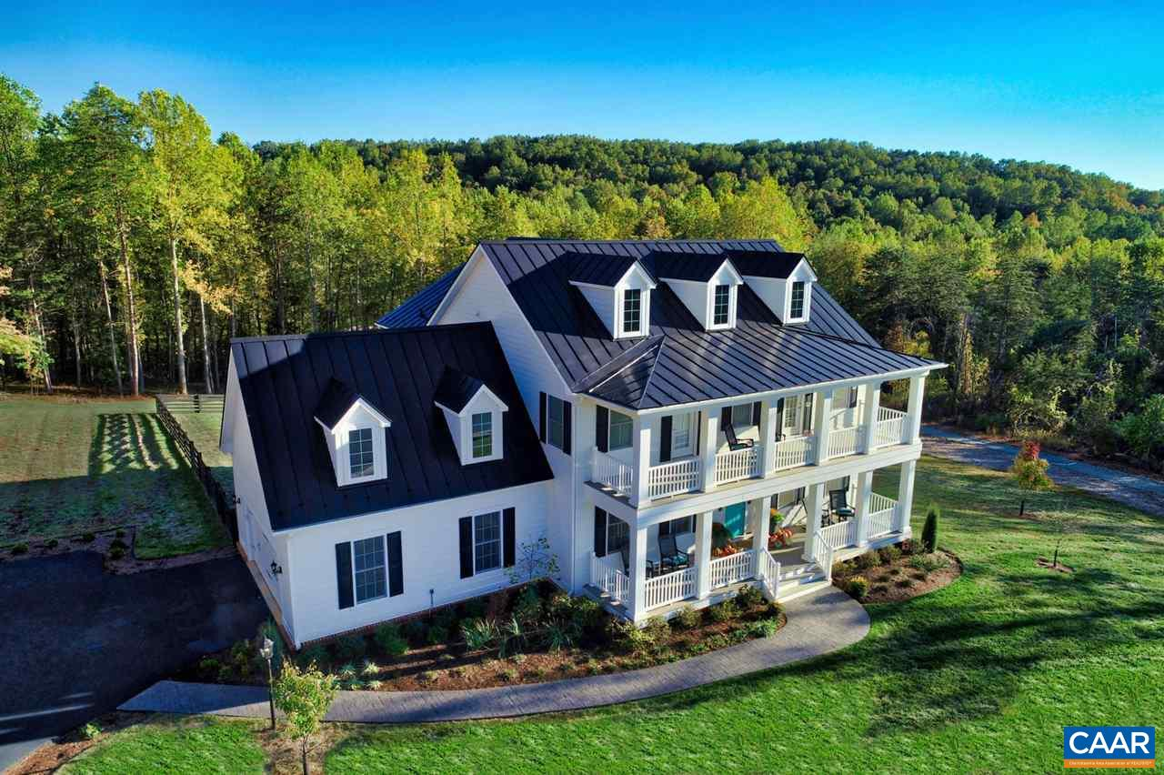 Open House Sunday 10/27 1-3pm.  One of only 6 homes built in The Reserve at Hyland Ridge just 3 miles from downtown Cville, this 5 BR classic white farmhouse is situated on a 2 1/2 acre preservation parcel in the top cul de sac. Enjoy beautiful Blue Ridge mtn views from the double front porches or the elevated brick & bluestone patio/firepit. Thoughtfully designed with welcoming center hall, an exquisite kitchen and impressive open flow, this 2017-built custom design is well appointed with many interior designer finishes and custom built-ins.  Enclosed rear yard with black board fencing adjoins the community nature trails. Premium energy efficiency (HERS score of 46), durability & comfort with this EcoSmart home.
