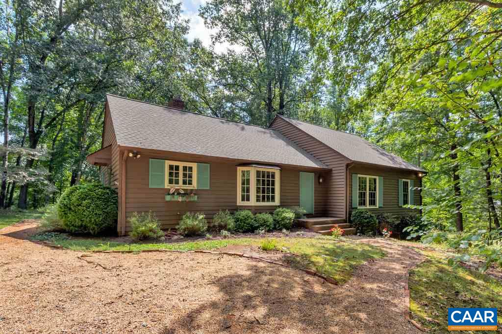 Fantastic Gerke-built home off Owensville Road in the Meriwether Lewis district is situated on a secluded lot surrounded by mature landscaping and hardwood trees. Backs to West Leigh with multiple walking options, this home boasts hardwood floors, spacious rooms, masonry fireplace, built-in shelves, first floor Master Suite, and so much more. Multiple living spaces on the first floor provide pus options for a home office. New Roof (5 years), new replacement windows, Redwood siding recently painted, excellent storage plus crawlspace sealed.  Recently painted interior and ready for your personal touch. Don't miss this opportunity!