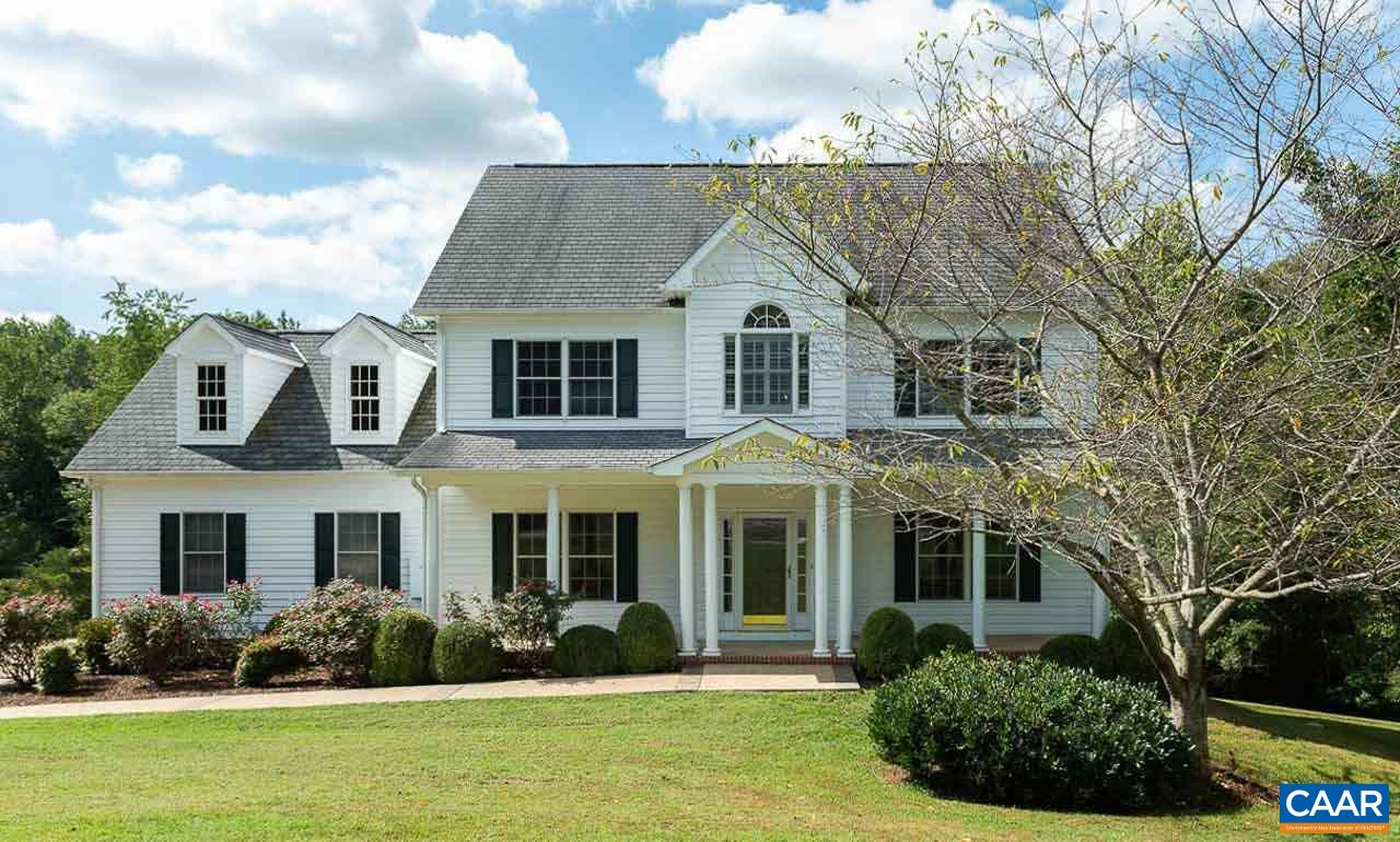 This spacious traditional style home was custom built by the current owner with nice touches: crown moldings and hardwood floors in living areas, granite counters, stainless appliances, a large island and desk area in the Kitchen. There's a formal LR and DR plus a nice open FR connected to the kitchen with space for informal dining, if desired. A screened porch off the FR enjoys the privacy of the one acre  yard and surrounding woods of the common area. Covered rear patio is wired for a hot tub. The yard is ready for pets w/an invisible fence. Whole house generator for peace of mind. Enjoy the quiet of this rural setting and the mountain views as you drive into Hickory Ridge. It's just 14 mins to groceries, 22 mins to Barracks Rd Shopping.
