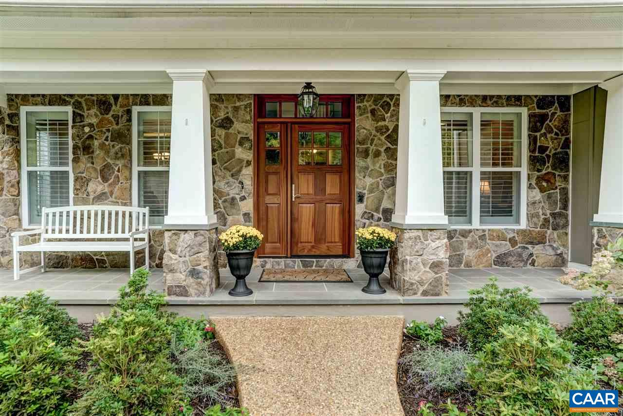 Open house Sun.11/3 from 1-3. Luxurious light filled open-concept home with amazing mountain, pond and wooded views in the sought-after subdivision of Hyland Ridge. Located minutes (3 miles) from all that downtown Charlottesville has to offer. Enormous chef's kitchen with coffered ceilings, custom cabinetry, butler's pantry and quartz counters. Fireplace and vaulted ceiling in the living room. First level master bedroom with sitting area and large master bath. Walk-out lower level is bright and roomy with game room, family room, home office or bedroom. Screened porch with stone fireplace and patio with  plenty of room to entertain. You could not duplicate this nearly new home with all of the extras on this spectacular Lot for this price!