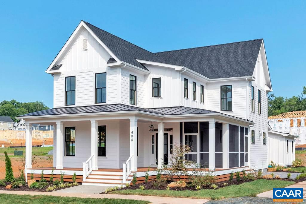 To be built 4 BR farmhouse with detached garage & finished studio above by local custom builder. Premium fit & finish NEW construction in the CITY neighborhood of LOCHLYN HILL, this 4BR, 3BA  design offers classic farmhouse charm with an inspired sense of style.  Prime city location within close proximity to downtown, spectacular views & a walkable lifestyle. Open main level with just over 2700 finished sq ft of living space, 2-car garage w/ loft apartment above, and large mudroom & laundry in main house. Side patio, wraparound screen porch in front. In addition to inspired design, premium craftsmanship and exceptional style, all of our homes include extensive energy savings features.