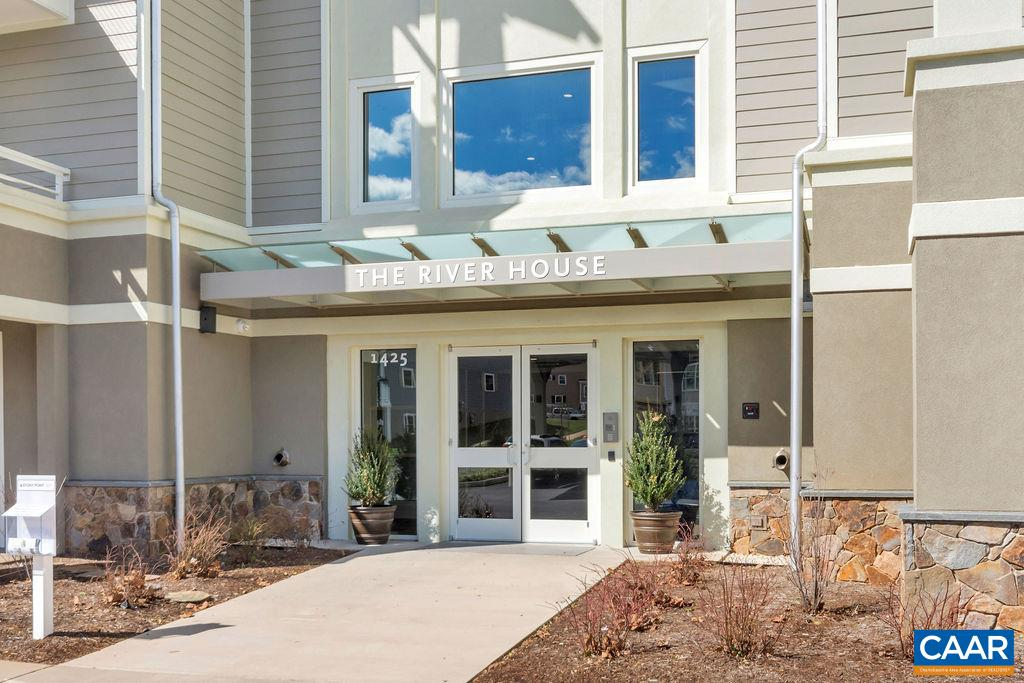 "Beautiful Craftsman-style 2-bedroom overlooking the Rivanna River features stainless steel appliances, granite counters, gas fireplace, 3¼"" hardwood and ceramic tile flooring, and a spacious private covered porch off of living room. Upgrades include custom shelving in bedroom closets, tile backsplash in kitchen and gorgeous custom mantle in living room. Walk out your door to access the Rivanna Trail, and enjoy luxuries such as on-site exercise room, separate storage locker, outdoor kayak rack, and keyless entry security. This condo also includes a designated covered parking spot. Energy efficient ""Earthcraft"" construction from an award-winning builder, steps from the Shops at Riverside Village & only 1.3 miles from C'ville's Downtown Mall!"
