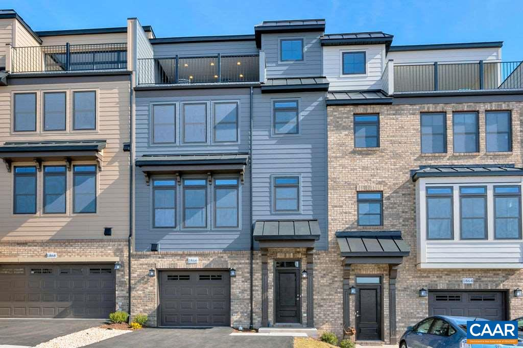 Virtual appointments available. Model leaseback opportunity. Brownstone style interior-unit Hartfield in Cascadia. Enjoy maintenance free-living in a great location with exceptional views. Rooftop deck included in this 4 bedroom/3-1/2 bath town home w/ 1-car garage. 24 foot wide footprint. Main level features an open floor plan with great room, dining room, and large kitchen. 2nd-level includes a Master suite, laundry w/ 2 additional BR's and full bath. Rooftop deck on 3rd floor. 1 BR and full bath on lower level. Pool, clubhouse, picnic pavilion, playground & lawn care included in HOA. Fiber optic internet available. Actual photos. HERS 58 and Pearl Certified Gold.