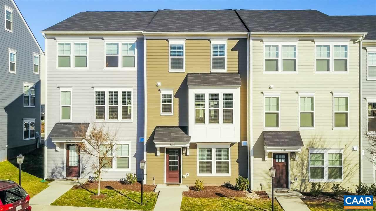 Immaculate townhome in Avinity only minutes from Downtown & 5th Street Station.  Seller chose extensive upgrades during construction; townhome like new.  See attached features list. Open floor plan on main floor with gourmet kitchen and spacious living space, including dining area which opens to large deck.  Home includes four floors that are tastefully finished. Terrace level features a private guest bedroom with full bath; 3 bedrooms on the 3rd floor with 2 full baths.  Inviting loft with fabulous wet bar, granite countertops, beverage refrigerator and cabinets, also access to Rooftop Terrace with mountain views—great venue for entertaining.