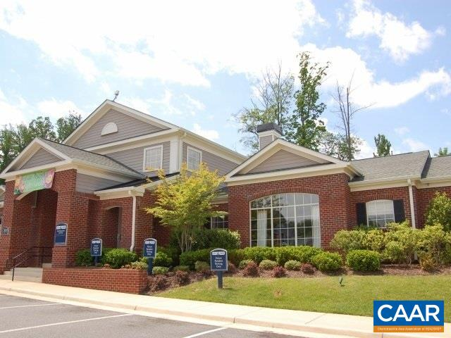 Great investment opportunity! Ground level 4 bedroom, 4 bath condo with laminate wood flooring throughout.  Each bedroom is equipped with a mini-refrigerator and microwave; washer & dryer included.  Spectacular amenities include: shuttle service to UVA and PVCC, basketball court, volleyball, tennis, pool, play area, clubhouse, and fitness center.  ALL BEDROOMS are leased for $2000 total per month.  Recently updated flooring and repainted; great condition!