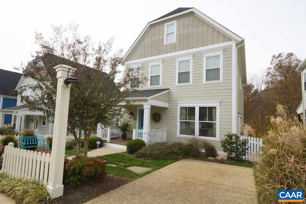 Impeccably maintained ,like new model home with loads of natural light and designer high-end finishes throughout :hardwood floors on 3 levels, built-ins in great room, elegant chef's kitchen, granite, marble, stainless steel, subway title, frameless shower enclosures, two fireplaces, central vac, and much more. City living  only steps from UVA & Downtown, Private mature woods in the back yard. Professionally landscaped with pergola, picket fence & garden bench. Seven acres of dedicateed open space with playground &  trails along forested creek bed....4 bedrooms,4.5 baths, 9' ceilings, covered front porch, sunny private deck, upgraded appliances, spacious work shop , gas FP, custom window treatments .HOA includes full lawn care. $524,900