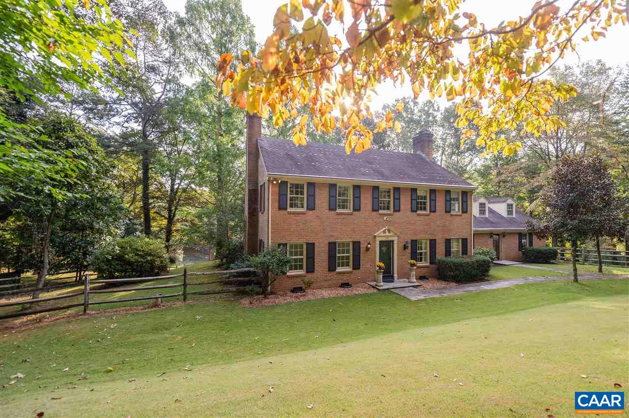 Do you like having water views or space between you & your neighbors? How about 3 wood-burning fireplaces, hardwood floors, spacious rooms? If so, then 110 S Indian Spring Rd is the home for you. This traditional 2 story Colonial fronts on private lake & is located in the established community of Carrsbrook. Special features include: recently renovated kitchen, large master suite, 1st floor bedroom suite, large recreation room, 2 home offices,oversized 2 car garage & fenced front and back yards. Wonderful 1.88 acre lot w/a park-like setting. Convenient location as this home is only minutes to shopping, business & schools. 5 miles to UVA, 6 miles to the Historic downtown and adjacent to the shops and stores on the 29 corridor.