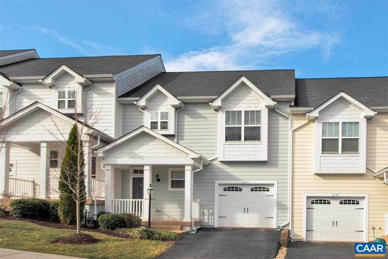 This desirable main level entry floor plan offers convenience and comfort with abundant light, hardwood floors and a half bath just off the foyer. An open expansive kitchen with breakfast bar offers plenty of cabinets and counter space with access from the garage for unloading groceries. Upstairs the loft imparts space for a home office, play area,  or TV/ reading room at the end of the day. Fire up the grill on the spacious deck and watch amazing sunsets. The deck and fenced backyard is buffeted by a natural backdrop of trees creating a sense of privacy- a rarity in the community. Stairs lead from the upper deck to the yard and lower level deck. Plenty of extra storage in garage and unfinished   basement, finish to suit your lifestyle.