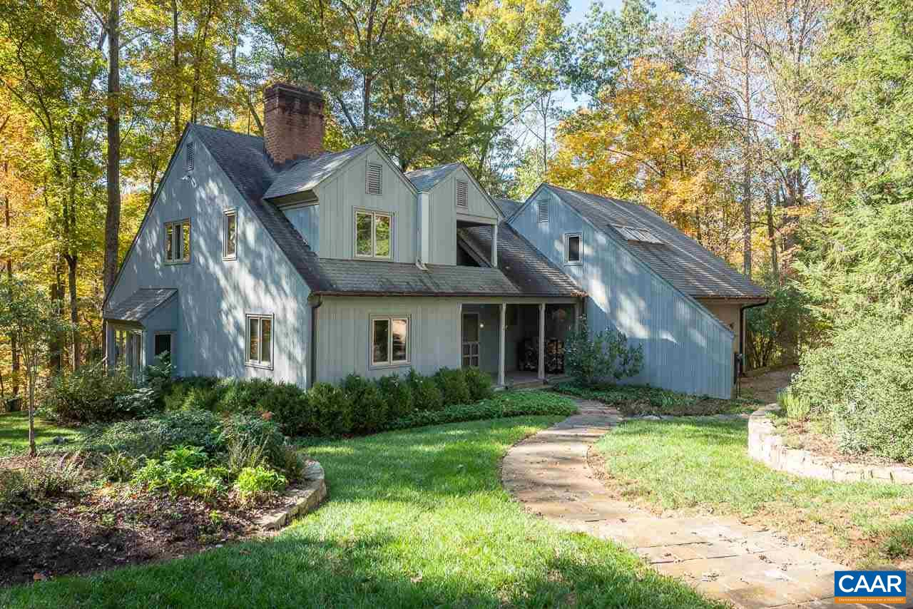 Tucked on a private 4+ acre beautifully wooded, secluded lot minutes west of town is this stunning Jay Dalgliesh designed 3 BR, 4 BA home with LR with FP, DR, eat-in kitchen, Master BR with FP and heart pine paneled study with fireplace.  Exceptional construction, comfortable spaces complete with wonderful details such as heart pine floors, trim and cabinets. Amenities include 3 fireplaces, several decks, screened porch and loads of charm and appeal. Lot adjoins Ivy Creek and contains pond and wonderful walking trails throughout the perimeter of the neighborhood.  Extraordinary light throughout the home from numerous large windows and skylights.