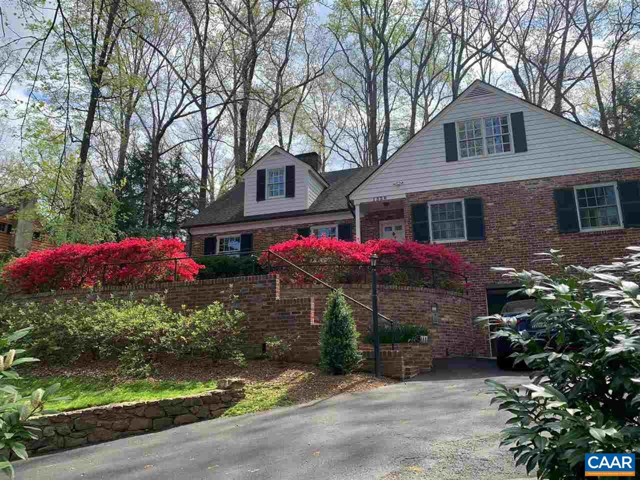 Prime location in Meadowbrook Hills close to UVA, hospitals, shopping & dining. The 6 bedroom home on .44+ acres features many upgrades (terrace level apartment, heated driveway, 3 car garage, 3 heating/cooling units w/ home divided into 5 zones for maximum comfort & efficiency, into extensive landscaping w/ seating, dining, waterfalls, antique millstones, fireplace, patios, cistern & more!), fireplaces, walk in closets, man cave/wine cellar, 2 bedrooms with ensuite & beautiful hardwood floors. Terrace Level:  1 Bedroom Apartment w/ Living & Dining Rooms, Fireplace, Kitchen, Laundry, Storage, Heated/A/C, Inside Access, Outside Entrance, Partial, Slab, Walk Out, Windows