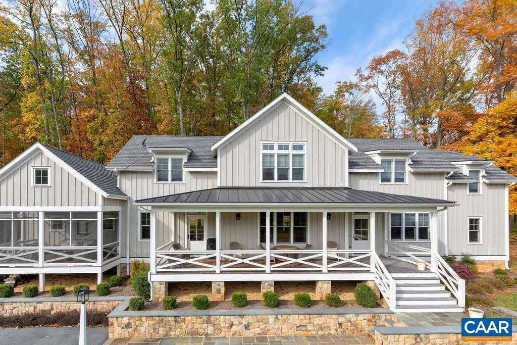 A stunning Rosney & Co. design custom built in 2014, this Virginia farmhouse is perched on a private 3.79 acre parcel at the back of Ragged Mountain Farms, expertly sited to take advantage of the rolling pastoral and mountain views. Thoughtfully designed with handsome architectural details, extensive trim & custom built-ins with gorgeous heart pine wide plank floors. An exquisite light-filled kitchen with painted cabinetry & soapstone counters + an impressive master suite further complimented by a framed Ragged Mtn view. Many unique spaces including a 1st floor guest bedroom, separate library/den, large mudroom & kitchen office. Coveted Ivy location in Murray Elem/ Western schools, within 10 mins to the University and just 15 to downtown.