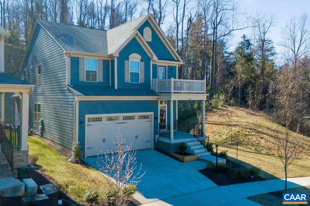 Sought after 2018 built CASCADIA 4 bedroom home on DELPHI LANE. WALK to the clubhouse and pool. Blue Ridge Mountain views from this fantastic CORNER location. VERY PRIVATE. Backing up to woods, you'll enjoy the private 12 x 12 stone patio & yard. Not having another home on one side provides privacy & great views. Rare opportunity to own a LIKE NEW home at this LOCATION. Over-sized front porch, 2nd level view porch & balcony, Cushion Close furniture grade cabinetry, granite counter tops, stainless steel appliances & hardwood flooring. Second level has a 16 x 14'5 Master Suite with 4 ft EXTENSION, a tray ceiling, view window, 2 enormous walk in wardrobe and 3 additional; bedrooms, laundry & full bath.FINISHED Terrace level: Rec room/full bath