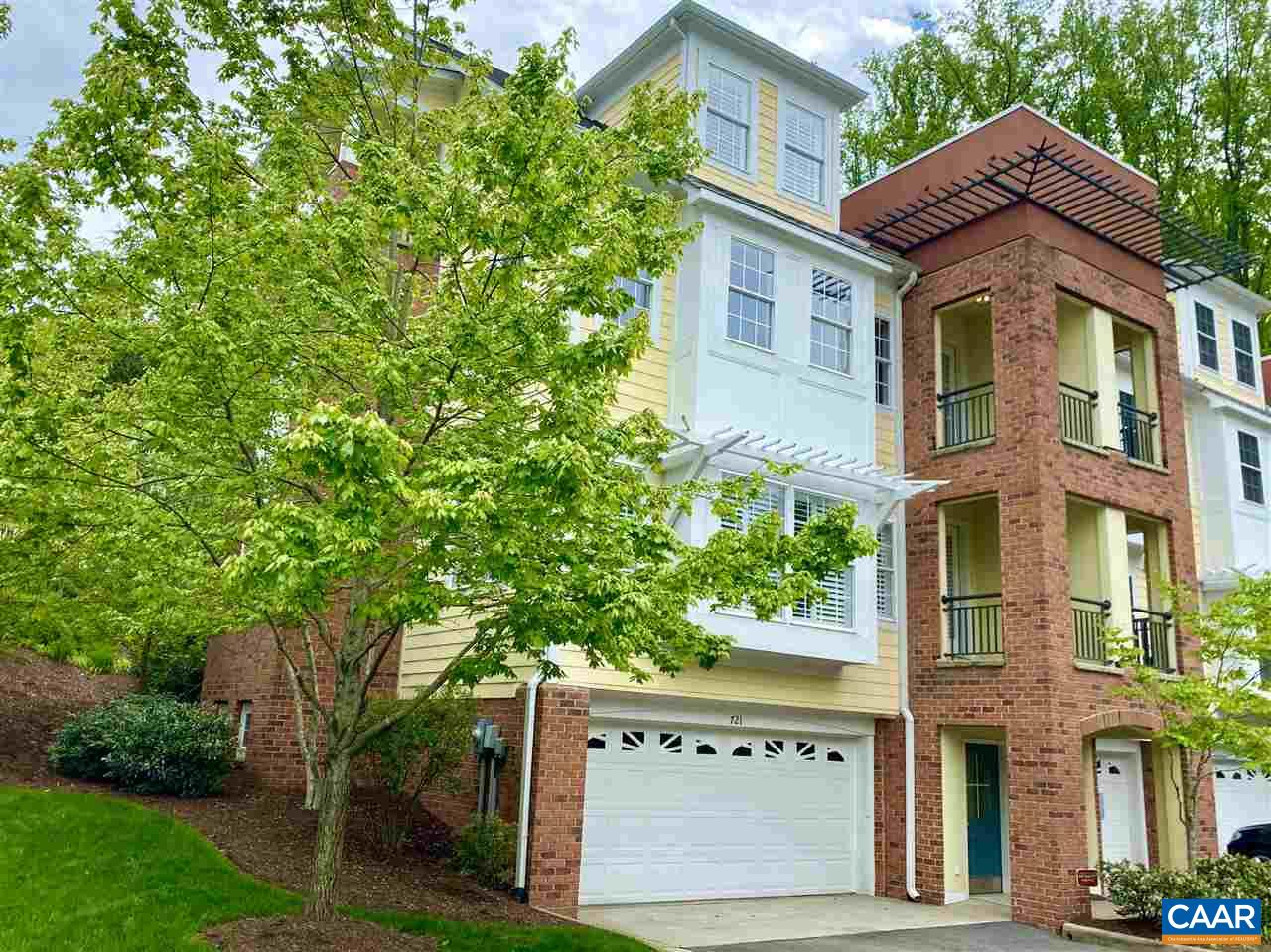 Stunning End Unit with Blue Ridge views in an ideal location w/in minutes to Downtown C'ville, Boars Head, Farmington and w/in walking distance to Scott Stadium, JPJ Arena. Open concept living on main level complete w/ 2 sided gas fireplace. Large chefs kitchen opens to a professionally landscaped blue stone rear patio with wrap around brick and iron decorative railing. Master bedroom on 3rd floor is large and boasts numerous windows for added natural light, large walk in California closet, en -suite bath complete with soaking tub and double sink vanity. 2nd en-suite bedroom on 3rd floor. 4th fl. offers 2 additional bedrooms and full bath. Ground level 2 car garage and storage room. Home includes an Elevator from garage to all floors.