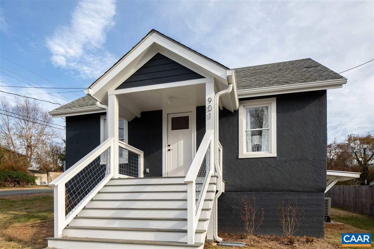 Completely renovated to nearly-new in 2019 by HubbHouse, this modern Belmont cottage blends clean lines with charming 1930s details. Perched high above Montrose Ave with mountain views, each space is flooded with natural light from multiple directions. Impressive living room features a vaulted ceiling, lofted office space, custom steel railing + ladder. All new systems - HVAC, plumbing, electrical - new roof, spray foam insulation. Ample storage in the conditioned, walk-in attic and unfinished basement (exterior access only). Modern hardscape design features crushed slate parking pad, stone path, outdoor dining patio. Situated in the heart of Belmont, just .25 miles to restaurants + shops, easy access to I-64, and 1.6 miles to UVA hospital.