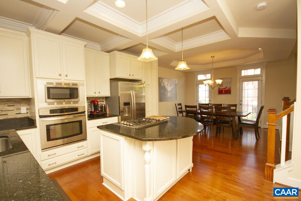 Previous Craig Builders model! Main floor is built around your gourmet kitchen. Oversized island w/ upgraded appliances, cabinets, & countertops. The trim work is amazing w/ coffered ceiling & crown molding throughout. Head upstairs to your dual master floorplan w/ big bedrooms & attached baths. Top floor gives you another room perfect for a family room w/ full bath. Step out on your roof top terrace to enjoy mountain views. Finished basement perfect as a guest suite or rec room. Multiple outdoor spaces plus flexible rooms fits any lifestyle w/ as many as 4 bedrooms w/ private baths. Garage is wired to plug in an electric car. Minutes to UVA & Downtown w/ clubhouse, dog park, gym, & playground. Video tour upon request!
