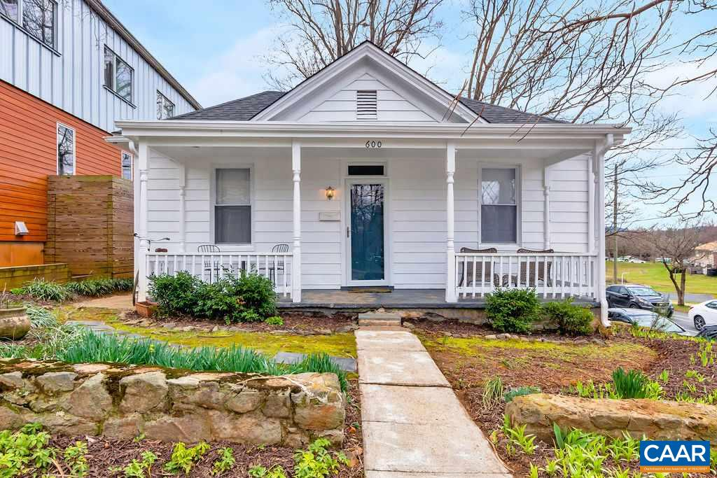 Adorable Belmont Bungalow steps from Downtown Belmont, IX Art Park, ACAC & the Downtown Mall. Spectacular corner lot with one-of-a-kind beautiful stone perimeter wall surrounding the property and perennial flower garden beds. Spacious front porch overlooking city view. Wide, welcoming foyer opens to a bright living room with built-ins.  Nice flow from kitchen to dining area.  Serene and sunny bedroom. Gorgeous original hardwoods, wide-trim details while also including newer windows and HVAC replaced in 2017.  Off street parking for 2 cars in back of property. So much to love about this property—fabulous yard space to enjoy, historic charm, and amazing location—all in the heart of the city.
