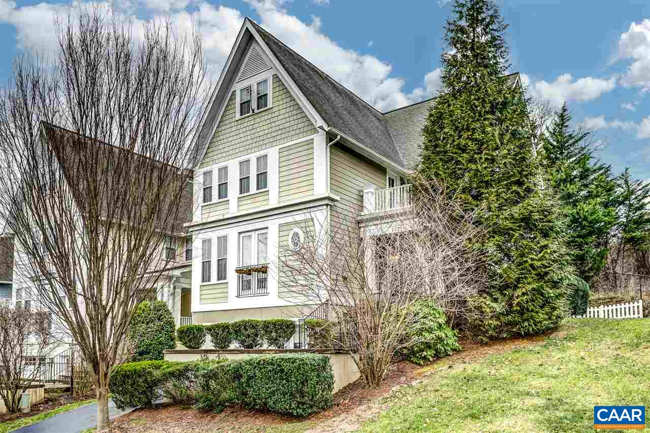 Walkability score on this fabulous light filled 5 bedroom, 3 full bath ( 2 half bath) open concept home with hardwood floors is through the roof! Only 1.5 miles from UVA!! This former model home has all of the updated extras available. Theatre room and full bath on the lower level and bonus room on the upper level. The cozy fire-placed family room opens to the kitchen which features a gas range, granite counters and high end stainless appliances. Roomy master bedroom with unique finishes, large mstr bath with soaking tub, ceramic tile and double sinks. This home will appeal to large families or the executive that desires a special property in close proximity to everything convenient. All of this AND a two car garage!