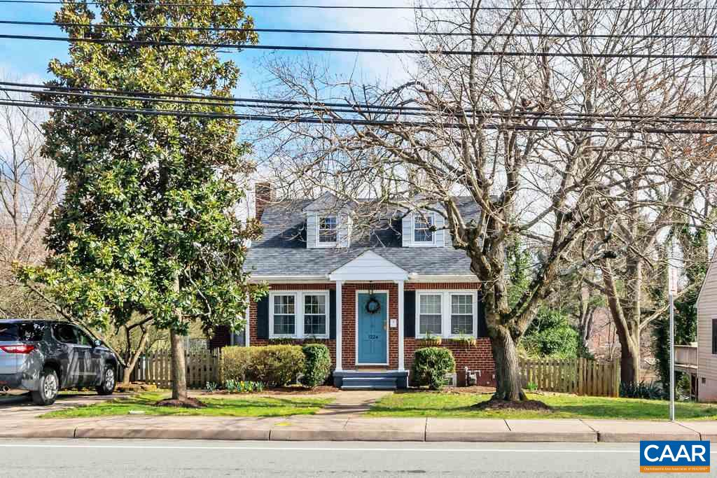 Meticulously REMODELED Cape Cod gem in the heart of the city with large, fenced backyard with mature landscaping and also backing to public wooded land. From the first step in, newly finished original hardwood floors impress, along with the abundance of natural light filling each room. The renovated kitchen has popular two-toned painted cabinetry, new quartz counters, subway-tile backsplash and new dishwasher & stove. This FOUR bedroom/2 full bath home also includes recent upgrades: new roof/soffits, new vanities and toilets in both bathrooms  and new tile in upstairs bath. Easy walk to UVA Hospital, campus and Downtown Mall. Close to bus stop and includes two off street parking spots. Basement includes additional room for extra storage.