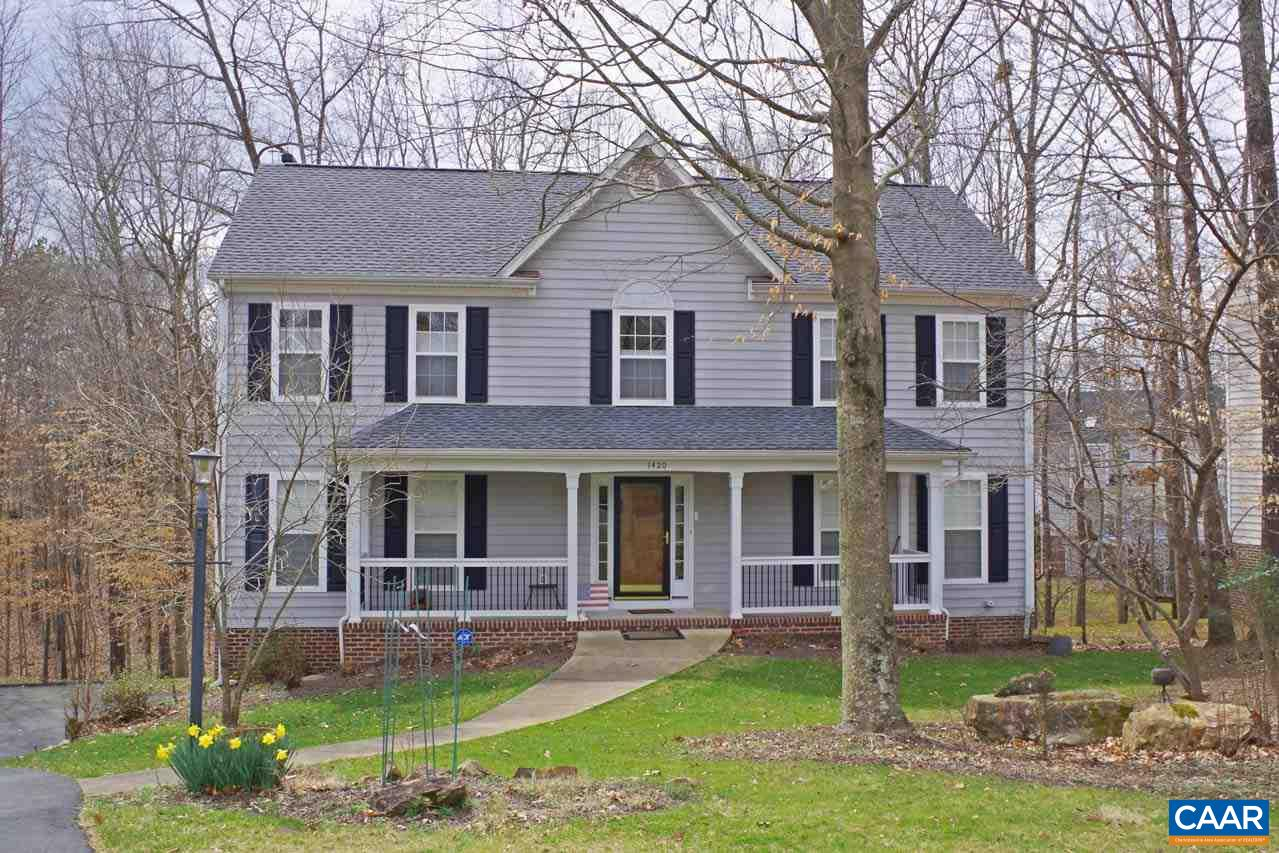 This well-maintained & light-filled home in the sought after Dunlora neighborhood features hardwood floors throughout much of the main level, dining room w/custom chair & crown molding, living room, family room w/fireplace & eat-in kitchen w/granite countertops & white cabinets. The second floor boasts a vaulted master suite w/a luxurious bath, 3 additional spacious bedrooms, hall bath & laundry. The basement serves as additional space for relaxing or would make a great play area for children. Other special features of this home include the oversized 2-car garage, large back deck overlooking common area, new 50-year roof, new water heater & more! Dunlora offers a pool, tennis courts, walk/run trails & is close to downtown and UVA!