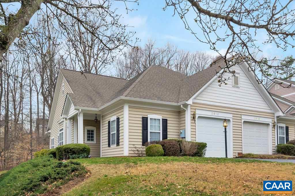 Video tour available upon request. Lovely one level, low maintenance home is perfect for downsizing without giving up comfort & style. This Forest Lakes villa style home features 10 foot ceilings, lots of windows, plus open floorplan for a sense of spaciousness.  Extensive hardwood floors are in the foyer, great room, kitchen & traffic areas. The kitchen features a stainless steel range, microwave & dishwasher (new in 2014) plus breakfast bar. In the master bedroom, a large bathroom with tile flooring, 4 foot shower & private water closet. Outside is ax extra  large private deck backing to wooded common area and paved walking trails. A secure one car garage (with new door) features pull down stairs to attic with added flooring for storage.
