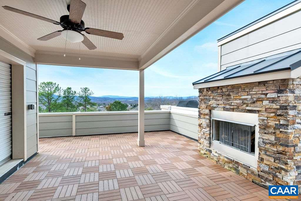 Gorgeous custom Avinity rooftop townhome with amazing mountain views just minutes to downtown! High end finishes inside & out with quality 2x6 construction, 9' ceilings, gourmet kitchen featuring granite counters, tile back splash, stainless steel appliances including wall ovens, natural gas cook-top with hood & beamed ceiling, gleaming wide-plank hardwood flooring, tray ceilings, crown molding, two gas fireplaces, attached garage, tank-less water heater, superb master bedroom with large walk-in closet and master bathroom with an over sized walk-in tile shower with tile flooring and double vanities with granite tops. The rooftop boasts covered & open outdoor living spaces, complete with ceiling fan, stone fireplace and incredible views!