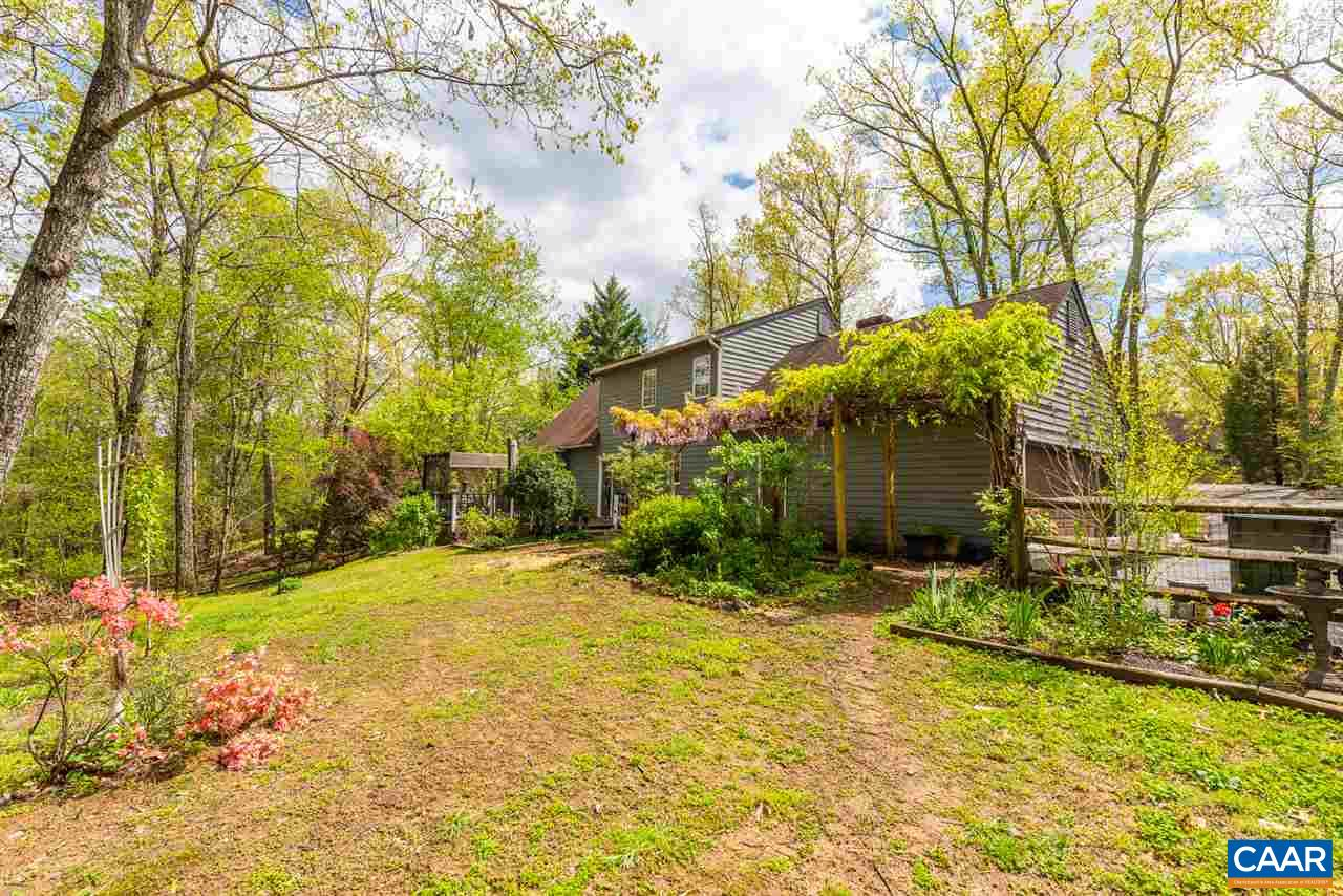 OPEN SUNDAY, 3/22 12-2pm! Huge, private lot located on a quiet street in the desirable Mill Creek South neighborhood, this charming home has a First Floor Master Suite plus 3 spacious Bedrooms and full Bath upstairs. Cozy gas fireplace in the Living Room with separate Dining Room next to the Kitchen overlooking the peaceful and private backyard. Large, attached 2-car garage with storage above. Enjoy the outdoor spaces with a huge rear deck, fruit trees, and perennials galore (owner is a Master Gardener)! Location can't be beat - 5 mins to 5th St Station (Alamo theater, Wegmans, restaurants), 10 mins to Downtown & easy access to I-64/UVA/hospitals.