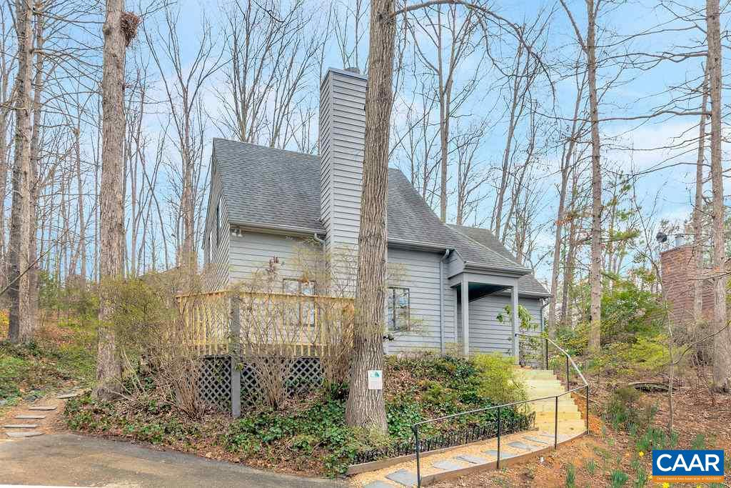 Recently renovated Mill Creek home with many quality improvements.  Elevated lot offers some of the best views in neighborhood, looking across Charlottesville to the mountains beyond.  4BR/2BA home with 1598 square feet, including 1st floor master.  Living Room with fireplace, recently rebuilt deck, new laminate flooring, new carpet in all bedrooms, entire house freshly painted, broken window seals replaced where needed, new master bath vanity.  Exterior siding and trim replaced where necessary, some gutter replacement, replaced front steps from parking area.  This house is neat and clean, and in good condition.  Countertops are in good shape but seller is offering a $2000 credit for upgrading.  Private back deck area. Convenient location.