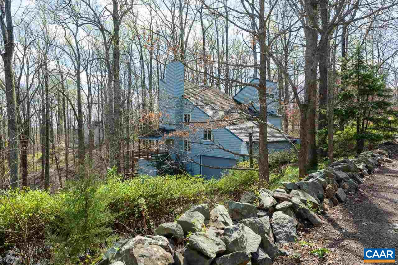 This one of a kind contemporary home in the prized Ednam Forest neighborhood enjoys winter mountain views from abundant floor to ceiling glass doors & windows & from 1100+ sf of outdoor decks. In summer this will be wooded privacy w/peeks of Carter's Ridge. This home has space to spread out over multiple levels and the kitchen is truly the heart of this home! There are formal living & dining spaces, plus two family rooms, both w/wood FP. The Owners Suite has a vaulted ceiling & a loft or retreat area, attached luxury bath, walk-in closet, & more windows to capture the sunrise. A handy study off the entry can be overflow guest space. The kitchen & baths all recently renovated, new flooring, appliances, paint, & beautiful Anderson windows.