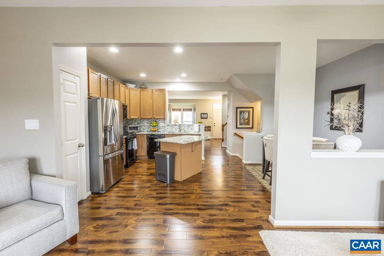 STUNNING RENOVATED TOWNHOUSE W/ 3BR, 2.5BA, HUGE BASEMENT, 2465 FINISHED SQ FT UNDER 350K IN PANTOPS AT PAVILIONS! EXCELLENT LOCATION MINUTES TO MARTHA JEFFERSON HOSPITAL, DOWNTOWN, UVA, SHOPPING, RESTAURANTS & MORE. Enjoy open floor concept on the mail level with gorgeous kitchen, dining and living space. Kitchen features beautiful granite counter tops with custom tile back splash. Master bathroom remodeled with custom tile, frameless glass door, soaking tub and double vanity is drop dead gorgeous. Large basement provides endless opportunities for man cave, home office, game room, gym, play room or just extra space. Mountain views from the back and space to grill off kitchen.