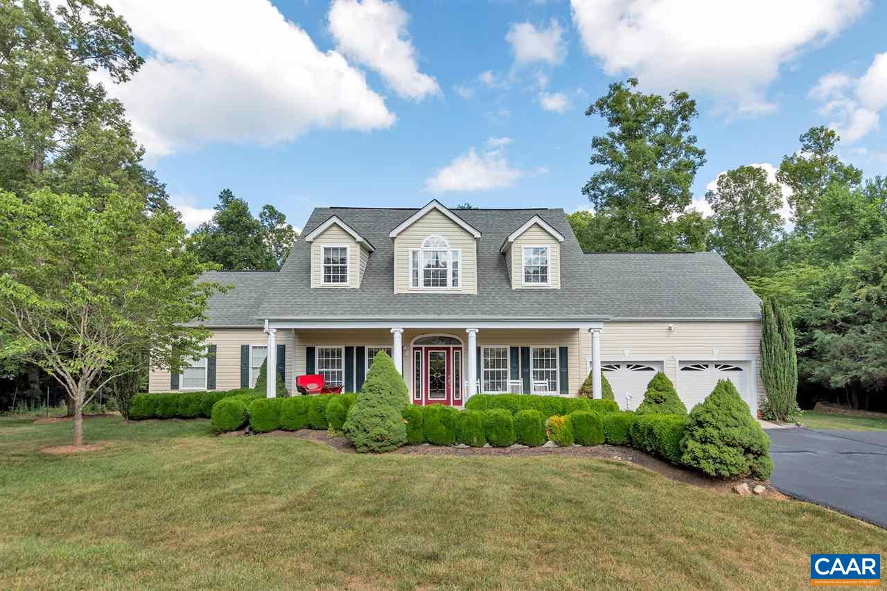Lovely custom home < 20 minutes east of C'ville w/ many custom features: country front porch, chair rail & crown molding, 1st level owner's suite, chef's kitchen, large family room, finished basement, home office, large rear deck w/ custom awnings, finished walk out terrace level, storage, 1st level laundry/mud room connecting two car garage, landscaped yard, 2 zone HVAC, paved drive, garden shed, drive resurfaced in fall 2019 & more.   Come see all this home has to offer!  You'll enjoy living in this lovingly cared for home w/ all the upgrades and appreciate the craftsmanship and value found in every room!