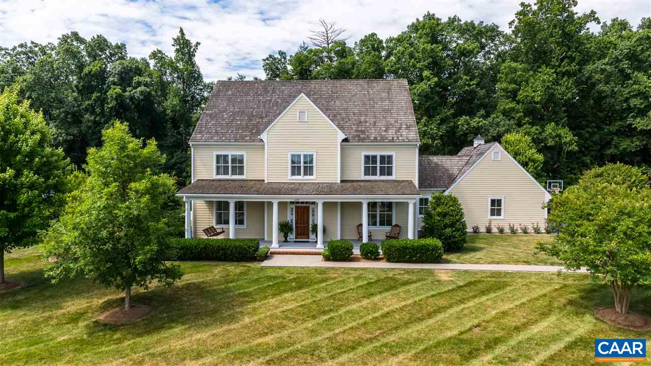Elegant, custom built home with true southern charm on the Old Trail golf course!
