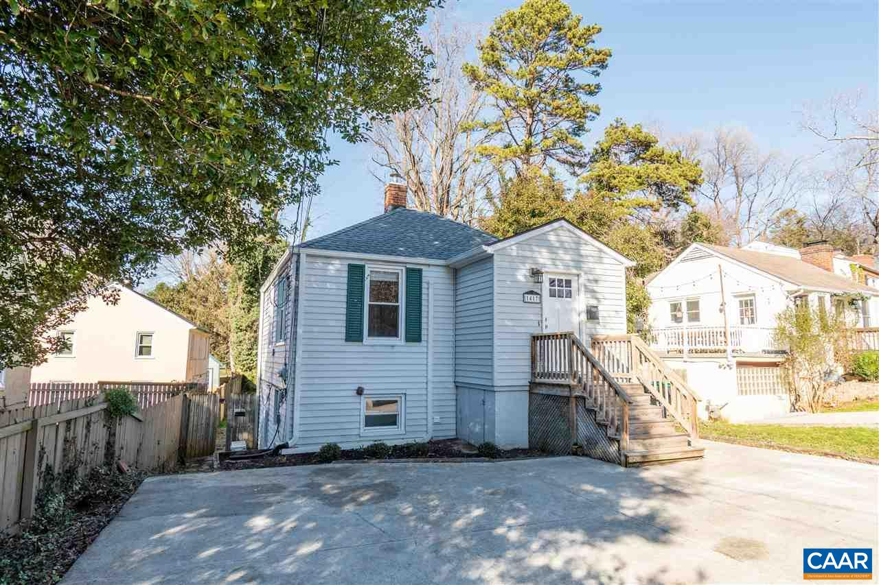 NEW PRICE! Charming, move-in ready 1940s cottage walkable to UVA Medical Center and Grounds, just mins to Downtown Charlottesville, Fifth Street Station and I64. Delightfully quirky floor plan with two levels. Exterior front stairs lead to the front porch and inviting foyer, then into the light-filled living room, two bedrooms and full bath. Lower level features a spacious dining room overlooking an expansive fenced-in backyard, plus kitchen and laundry/utility space. Seller has lovingly updated this home with fresh paint, refinished hardwood floors, new tile flooring, fully-renovated bath with new tile and fixtures, newer roof and gutters, upstairs mini-split for cooling and extra heat, new kitchen countertops. Ample off-street parking.