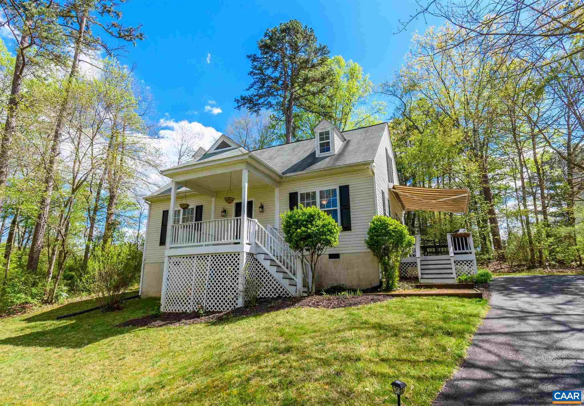 Well-priced and well-maintained 3BR 2BA Cape Cod style house in popular Twin Lake Estates with 1,482 finished sq ft on two levels. Sited on over two-thirds of an acre, on an elevated, partially wooded lot, this house offers privacy with Blue Ridge views from almost every room! There is a wonderful side porch/deck with a retractable awning for those sunny days and cozy evenings. Main level features include a spacious living room, large eat-in kitchen opening onto the inviting side porch/deck, and two generously-sized bedrooms plus full hall bath. Current owner thoughtfully transformed the second floor into a master suite with large walk-in closet and full bath. Located minutes from Rt 29 and points north and south. A short drive to NGIC/DIA, and a few mins further down Rt 29 to the Charlottesville Airport and Hollymead Town Center. Downtown Charlottesville is 30-40 mins depending on time of day and traffic conditions. HOA maintains the ponds and the roads.