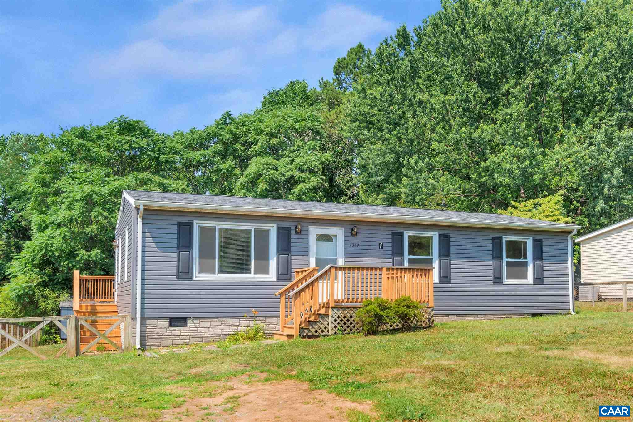 Don't miss this move in ready 3BR home in the heart of Crozet. Mountain views! Home had roof, AC, gas furnace replaced in 2015 as well as an updated bathroom at that time. Kitchen was updated in 2013. Large rear deck that looks onto fenced back yard with mature trees backing up to a wooded area. Plenty of room for an addition. Minutes from downtown Crozet shopping, breweries, restaurants, parks and great Western Albemarle schools!