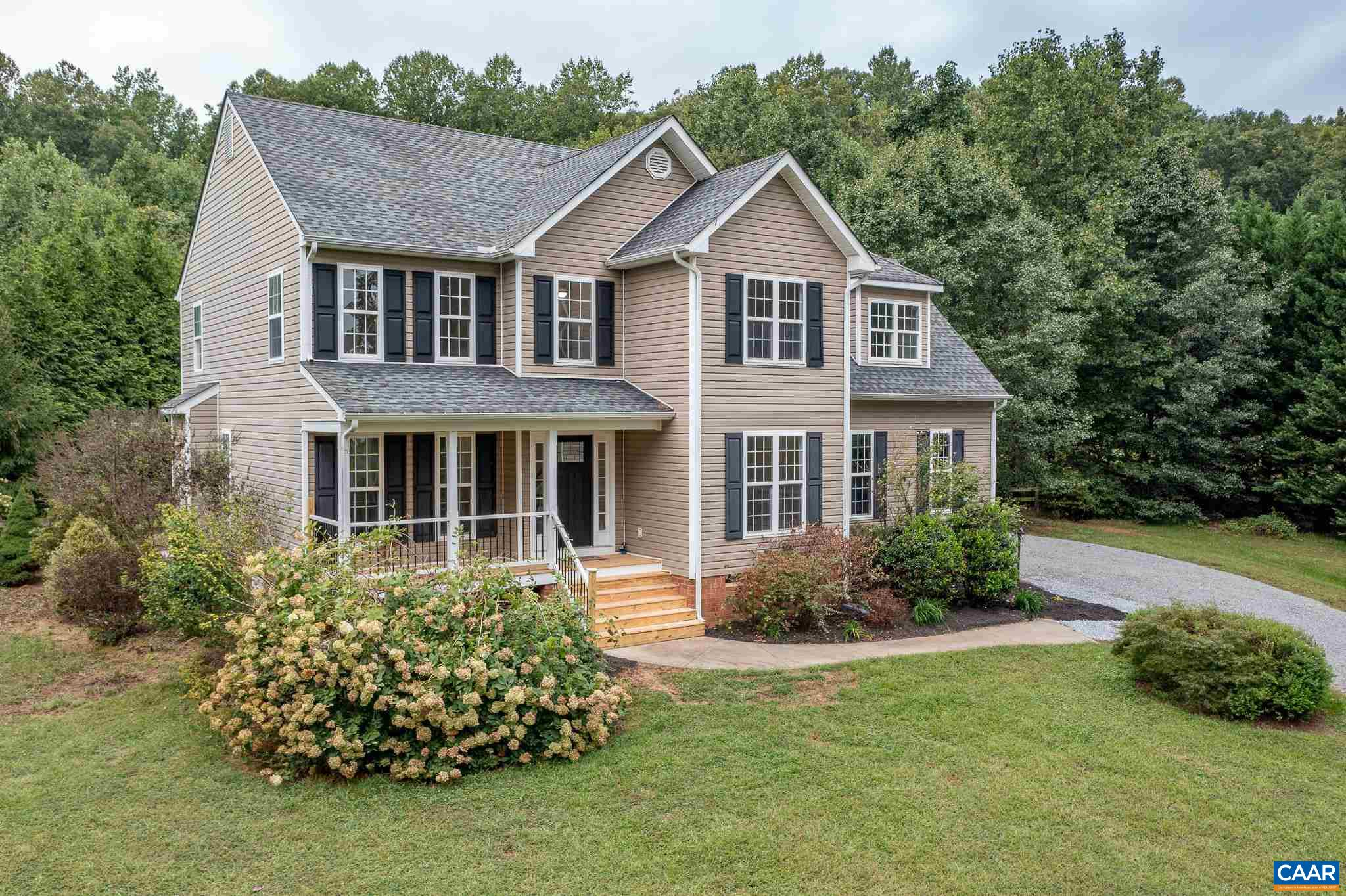 OPEN HOUSE SUNDAY 9/26 1:00-3:00! Beautifully updated quiet, country colonial on over 1.6 acres just across the Greene County line. Freshly painted throughout, the main level features hardwood floors, brand new LVP in the kitchen and sunroom, and newly installed carpet in the living room. The 2nd level showcases all 4 bedrooms, laundry room, new flooring throughout, as well as a spacious master bedroom with a walk-in closet updated master bath. The 2nd bedroom also features an en-suite bathroom. Enjoy the sunrise from the new, covered front porch and the sunset from private, landscaped back patio. The fully fenced backyard is perfect for your pets!